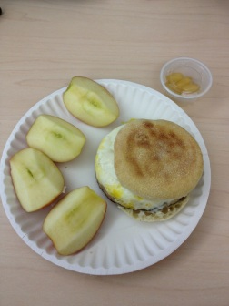 Muffin, eggs, chicken breast slices and apple