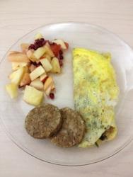 Omelette, breakfast patties and fruit